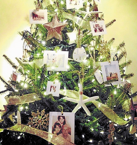 The Lloyd family uses the holidays as a way to reflect on the year's events. At the same time, they use photos from the year to adorn their Christmas tree.