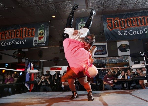 Marty the Pint-sized Party slams The Bronx Thug to the mat during a bout Saturday, Dec. 15, at Club Texas in Auburn.