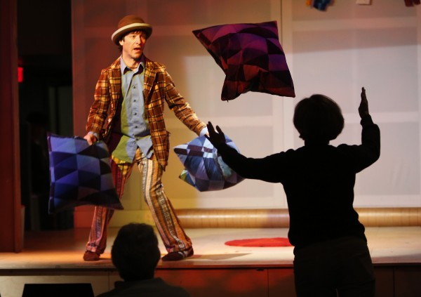 Daniel Forlano juggles pillows with a member of the audience during a Phyzkidz show, on Thursday, Dec. 27. 2012, at Space Gallery in Portland. Forlano has performed as far away as South Africa and New Zealand.