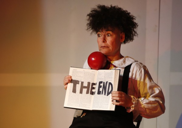 After catching a ball on top of a dictionary, Iman Lizarazu opens the book to mark the conclusion of the skit during a Phyzkidz show on Thursday, Dec. 27. 2012, at Space Gallery in Portland.