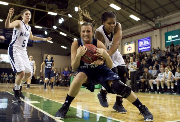 Rhode Island's Megan Straumann and Maine's Chantel Charles battle for a loose ball in the second half at the Portland Expo on Saturday, Dec. 8, 2012, in Portland.