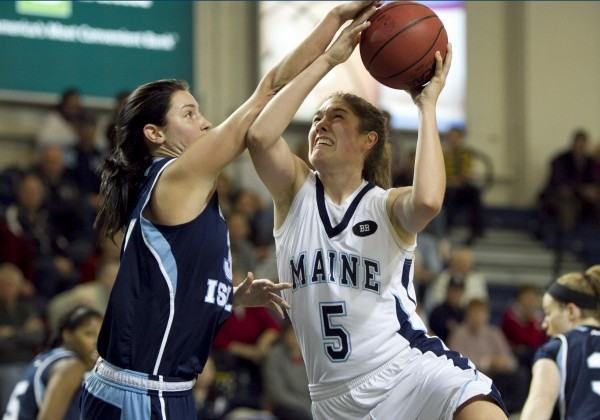 Maine's Danielle Walczak drives to the hoop against Rhode Island's Samantha Tabackman in the first half at the Portland Expo on Saturday, Dec. 8, 2012, in Portland.