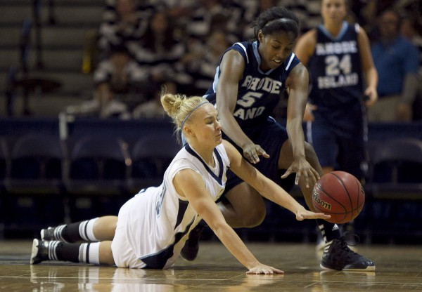 Maine's Sophie Weckstrom dives for a loose ball against Rhode Island's Ajanae Boone in the first half at the Portland Expo on Saturday, Dec. 8, 2012, in Portland.