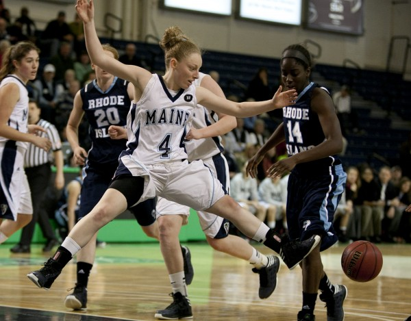 Maine's Courtney Anderson is stripped of the ball while driving to the net in the first half against Rhode Island at the Portland Expo on Saturday, Dec. 8. 2012, in Portland.