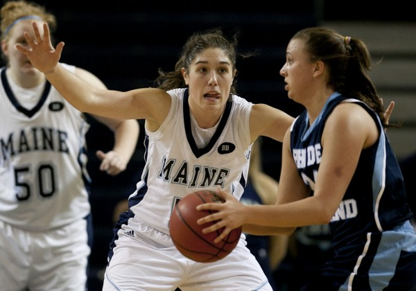 Maine's Danielle Walczak guards Rhode Island's Megan Straumann in the second half at the Portland Expo on Saturday, Dec. 8, 2012, in Portland.