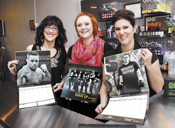 Regina Leonard (right), co-owner of The L Factor in Brewer and project leader for the Man Up to Cancer calendar, shows off one of the calendars along with her business partner Jodi Leighton (left) and employee Stephanie Knowles. Leonard wanted to draw attention to men's cancers with the calendar, which she hopes will raise at least $10,000 that will be donated to the Lafayette Family Cancer Center.
