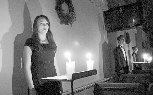 "Casting multiple shadows against the sanctuary walls at First United Methodist Church in Bangor, candles provided the only illumination during a Sunday, Dec. 2 concert by the Mount View Chamber Singers from Thorndike. Drawn from talented students at Mount View High School, the choral group sings a cappella during its ""Carols in the Round"" 2012 concert season."