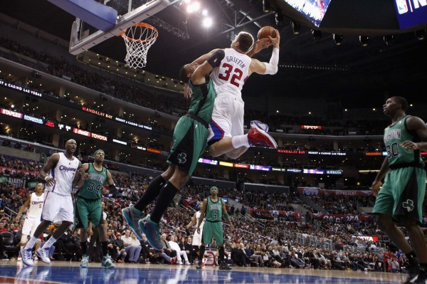 Boston Celtics' Jared Sullinger is called for a flagrant foul as Los Angeles Clippers' Blake Griffin (32) attempts a dunk while Clippers' Lamar Odom (bottom, left) and Celtics' Paul Pierce (34) Jason Terry (4) and Brandon Bass (right) look on during the second half of their NBA basketball game in Los Angeles on Thursday, Dec. 27, 2012.