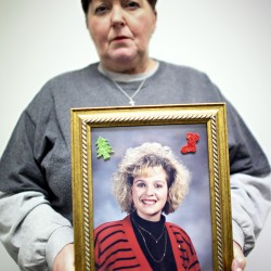 Barbara Howard holds a picture of her daughter, Leslie Cooper, who died of a drug overdose in 2009.