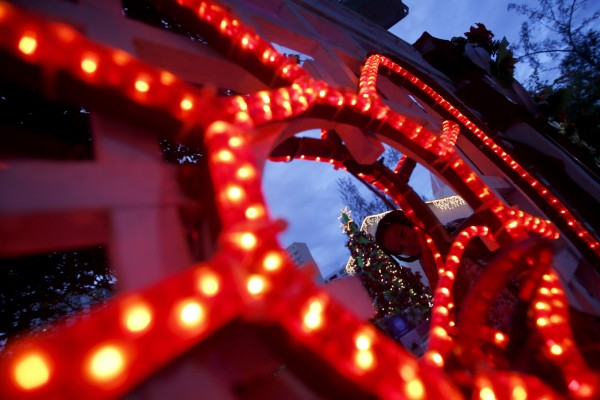 A girl plays next to Christmas decorations in Rio de Janeiro on Tuesday, Dec. 18, 2012.