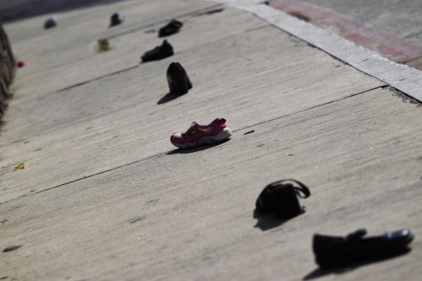 Shoes are placed on the streets between the Mexican and U.S. embassies to symbolize the crossing of Central American migrants between both countries, in commemoration of the 22nd anniversary of International Migrants Day, in Guatemala City, Guatemala, on Tuesday, Dec. 18, 2012. More than 75,000 Central American migrants were deported from Mexico in 2012, and many others have been victims of abuse, kidnap and murder by organized crime gangs on their way to the U.S., according to an activist from the National Office of Migrants.