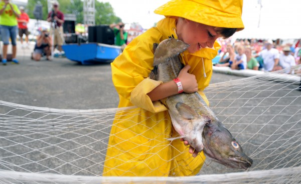 Nine-year-old Noah Lachance, of Camden was the fastest in the Children's Cod Fish Carry event at the 65th annual Maine Lobster Festival in Rockland on Sunday, Aug. 5, 2012.