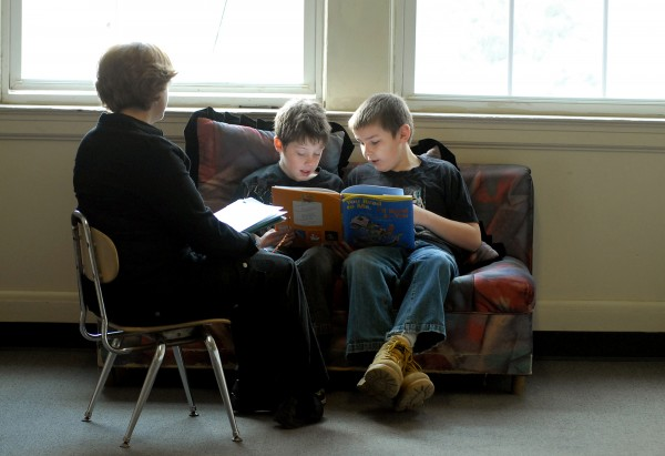 Fourth graders Michael Raymond (center) and Tim McCann (right) have reading time with education technician Sarah Perkins (left) at the Fairmount School in Bangor on April 12, 2012. Bangor schools rank among the best in Maine, which according to Superintendent Betsy Webb is the result of a program that assesses individual student progress on a regular basis.