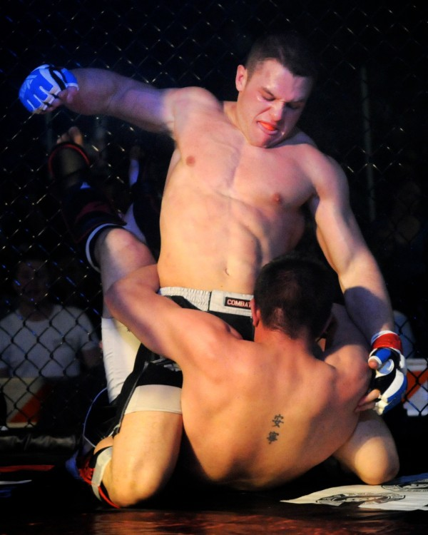 Tim Grovo pummels Zach Labbay in an amateur mixed martial arts fight at the Biddeford Arena on Saturday night, April 14, 2012. Grovo was the winner by TKO.