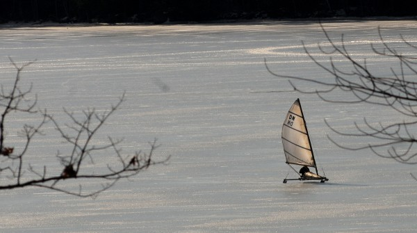 An ice boat sails across Davis Pond in Eddington. The lack of snow and cold temperatures and rain created the perfect conditions on lakes and ponds for skating and ice boat sailing.
