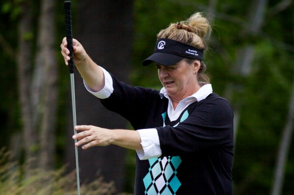 LPGA Legends Tour golfer Cindy Figg-Currier lines up a putt at the Hannaford Community Challenge Tournament in Falmouth on June 24, 2012. Figg-Currier finished fourth, coming in one over par.