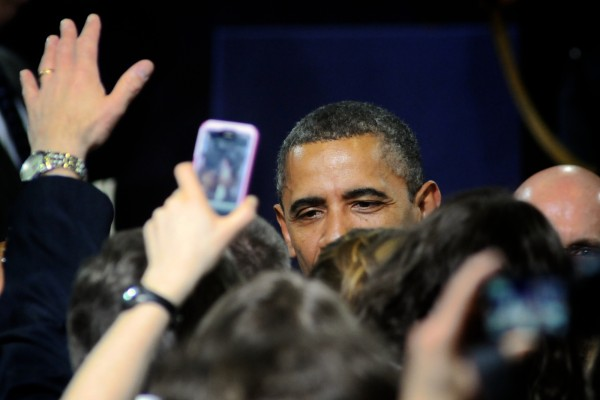 President Barack Obama gets swallowed by the crowd at Southern Maine Community College in South Portland on March 30, 2012.