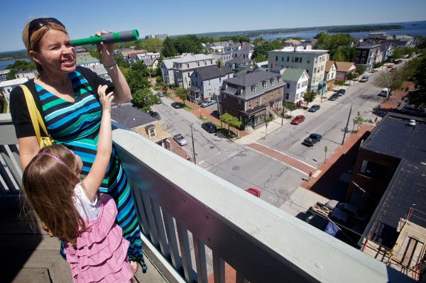 Stephanie Davis and daughter Lilia, 5, play with a toy telescope at the top of the Portland Observatory on Munjoy Hill on June 14, 2012.