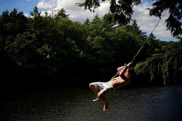 Brett Miller of Saco swings over the Saco River in Buxton's Pleasant Point on Aug. 6, 2012.