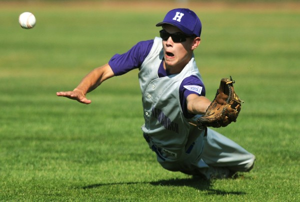 Hampden's Cody Varney dives for a line drive to right field during the first inning action on Saturday, Aug. 4, 2012, during the District 3 tournament against Houlton at Mansfield Stadium in Bangor.