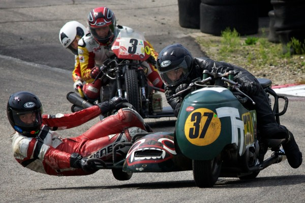Racers take a tight turn at the United States Classic Racing Association Grand Prix in Loudon, N.H., on June 11, 2012.