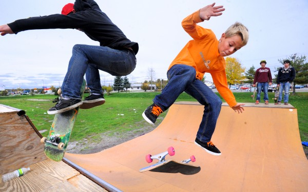 Gage Stuart, 10, of Corinth performs a fakie heal flip as Chaz Nelson, 20, of Bangor executes a hard flip nose stall while skateboarding at the Bangor skate park Oct. 7, 2012.