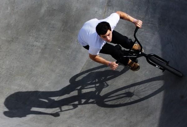 Alex Dodge circles the pool on his BMX at the Portland skate park on April 30, 2012.