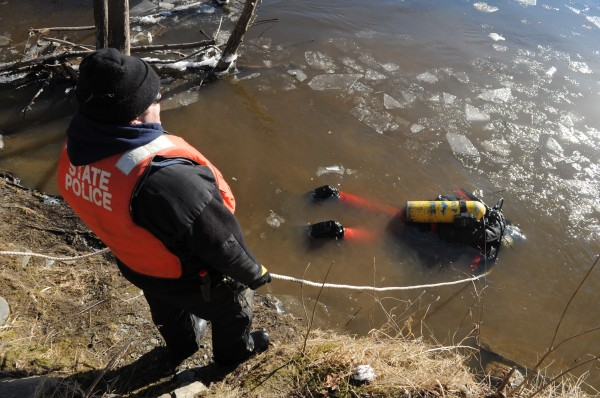 Members of the Maine State Police dive team search the water near the Waterville boat launch on the Kennebec River for clues related to the disappearance of Ayla Reynolds on Wednesday, Jan. 11, 2012.