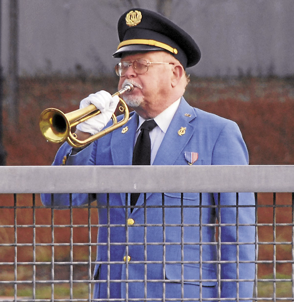Trumpeter Hal Wheeler blows Taps during the Pearl Harbor Day ceremonies held in downtown Bangor on Friday, Dec. 7, 2012.