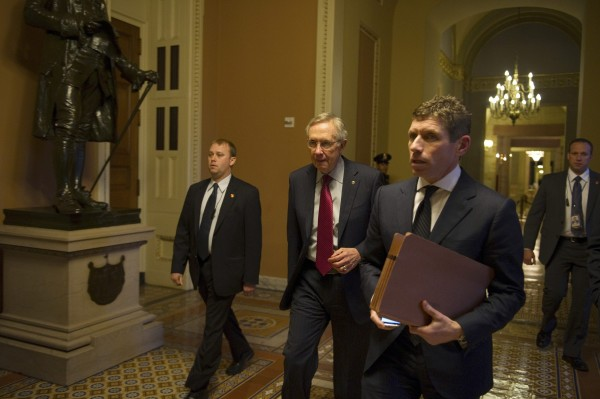 Senate Majority Leader Harry Reid, D-Nev., (2nd left) walks with unidentified aides and security to his office in Washington, D.C., after returning from a meeting with President Barack Obama at the White House on Friday, Dec. 28, 2012. Congressional leaders pledged to keep working on solutions to avert the year-end tax hikes and spending cuts that would come into force if the so-called fiscal cliff is not averted, but details were yet to be decided after a meeting with President Obama at the White House on Friday.
