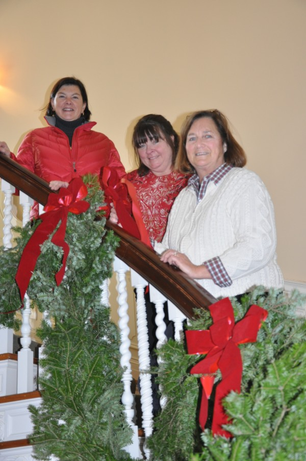 Volunteers finish decorating the Maine Sea Coast Mission's Colket Center for this Friday's Holiday  Open House fund-raiser.