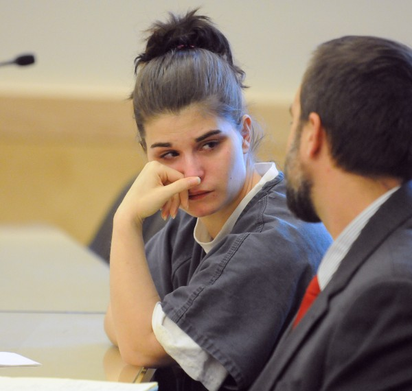Katie Dube, 27, of Glenburn speaks with her attorney Tzovarras Hunter in the courtroom at the Penobscot Judicial Center in Bangor on Monday. Dube withdrew her guilty plea after District Court Judge Bruce Jordan rejected her plea agreemant to serve a maximum of 17 years in prison.