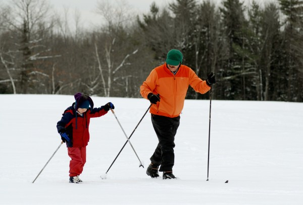Jackson Haskell, 5, of Bangor enjoys an afternoon of cross country skiing with his father Scott Haskell at the Bangor Municipal Golf Course on Tuesday, Dec. 27, 2011.