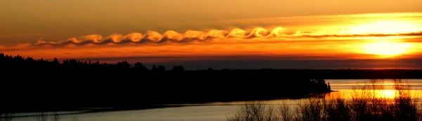 Tuesday's Christmas morning sunrise over the seaside Washington County community of Steuben included a most unusual spiral cloud formation that, in effect, created waves in the post-dawn sky.