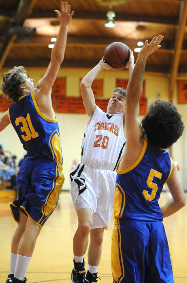 Jay's Jake Lord goes for the shot between Mt Abram defenders Kenny Moir (left) and Lincoln Dyar in a game played at Jay during Lord's high school basketball days.