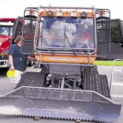 """During a recent """"Touch-A-Truck"""" event held at the Cole Land Transportation Museum in Bangor, visitors examine the Tucker Groomer belonging to the Penobscot Snowmobile Club in Hermon."""
