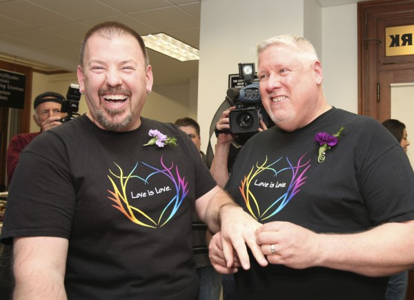 Same-sex couple Steven Bridges (L) and Michael Snell exchange rings after filling out a marriage license at the City Hall in Portland, Maine December 29, 2012. Same-sex couples started marrying on December 29 in Maine, a state that made history on Election Day, joining Maryland and Washington to legalize gay weddings for the first time ever by popular vote.
