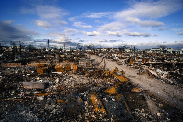 Clouds roll over destroyed homes, almost two months after superstorm Sandy caused damage, in Breezy Point in the Queens borough of New York City, on Thursday, Dec. 27, 2012.