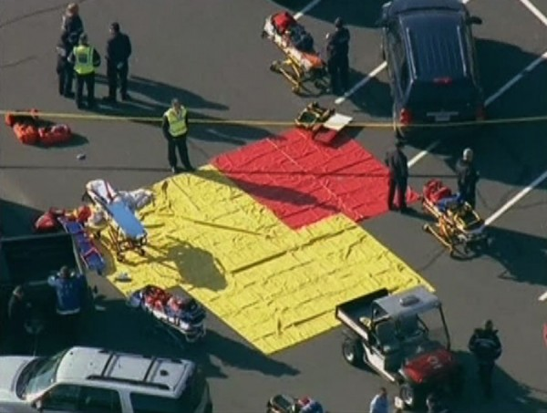 Emergency personnel set up in the parking lot after a shooting at Sandy Hook Elementary School in Newtown, Connecticut, December 14, 2012.