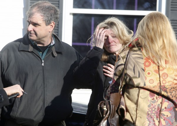 Relatives react outside Sandy Hook Elementary School following a shooting in Newtown, Connecticut, Dec. 14, 2012.