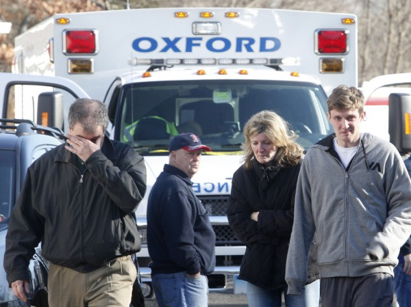 Relatives react outside Sandy Hook Elementary School following a shooting in Newtown, Connecticut, December 14, 2012. At least 27 people, including 18 children, were killed on Friday when at least one shooter opened fire at an elementary school in Newtown, Conn.