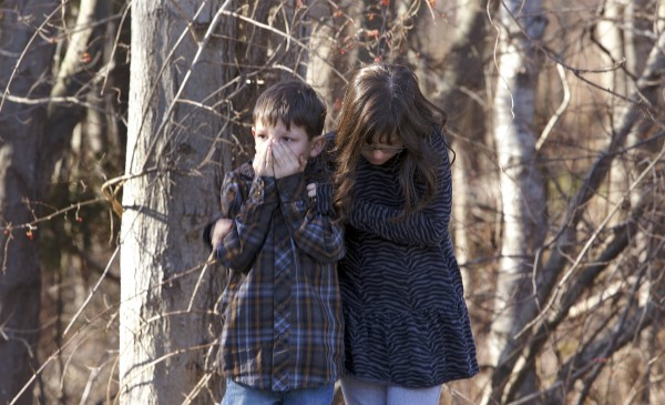 Young children wait outside Sandy Hook Elementary School after a shooting in Newtown, Conn., December 14, 2012.