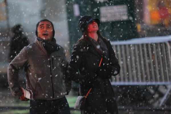 People walk in a winter storm in Times Square in New York, on Wednesday,  Dec. 26, 2012. The severe winter weather that hit parts of the central and southern United States on Christmas Day moved eastward on Wednesday, causing flight delays and dangerous road conditions in the Northeast and Ohio Valley.