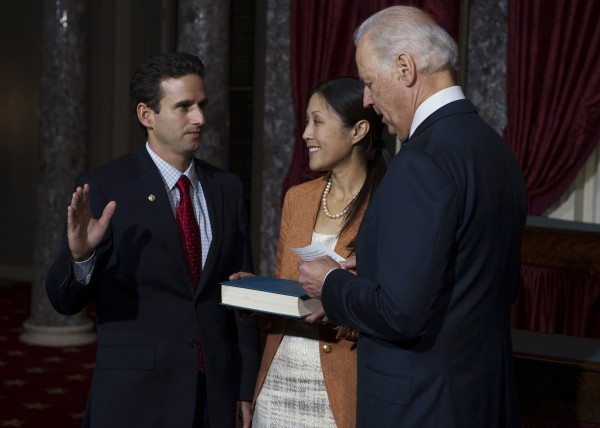 U.S. Sen. Brian Emanuel Schatz (D-HI), who replaced the late Sen. Daniel Inouye, stands with his wife, Linda, while Vice President Joe Biden administers the oath of office during the re-enactment of his swearing-in ceremony in Washington, D.C., on Thursday, Dec. 27, 2012.