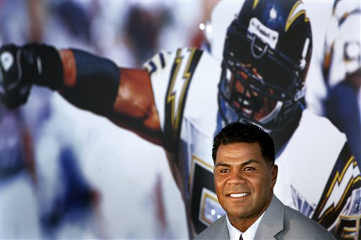 Former San Diego Chargers football player Junior Seau smiles during a news conference announcing his retirement from pro football in San Diego in August 2006. Seau, a former NFL star, was found dead at his home in Oceanside, Calif.  He was 43.