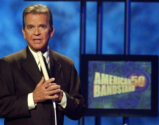 Dick Clark, host of the &quotAmerican Bandstand&quot television show, introduces entertainer Michael Jackson on stage during taping of the show's 50th anniversary special in Pasadena, Calif. in April 2002. Clark, the television host who helped bring rock `n' roll into the mainstream on &quotAmerican Bandstand,&quot died  April 18, 2012 of a heart attack. He was 82.