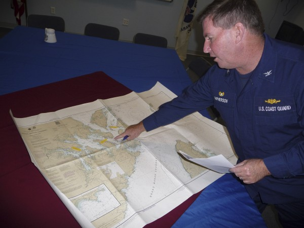 U.S. Coast Guard Capt. James McPherson, commander of Coast Guard Sector Northern New England out of Portland, points to the search area on a chart of Cobscook Bay in October 2009.