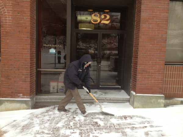 Mark Perry shovels the front of the building he works at on Columbia Street in Bangor on Thursday morning, Dec. 27, 2012.