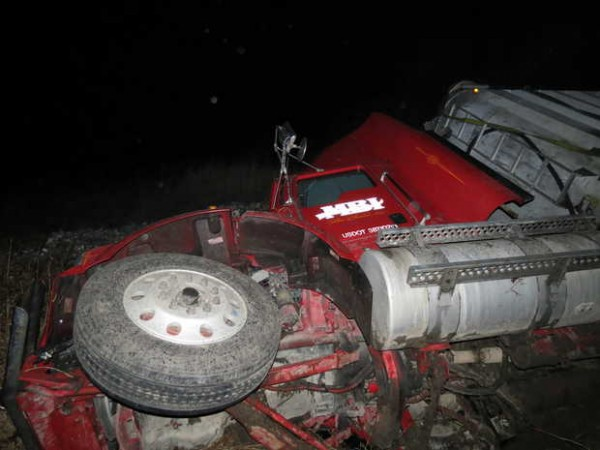 A northbound tractor-trailer rig went off Route 4 near Lake Auburn on Monday night, spilling much of the garbage it was hauling. The driver was injured and taken to a hospital.