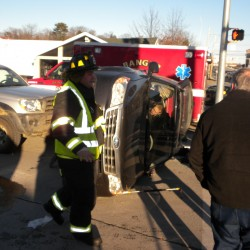 Collision leaves car lodged under tractor-trailer in Hampden
